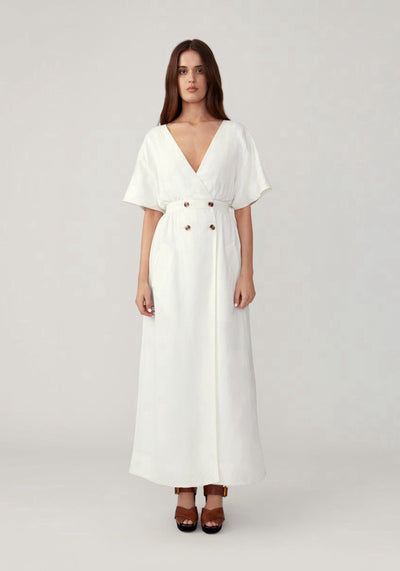 Woman in ivory button front sleeved dress front.