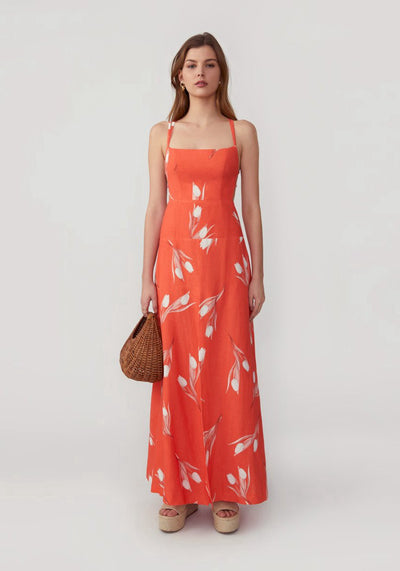Woman in white tulip orange ankle dress front.