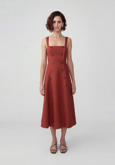 Woman in rust button down midi dress front.