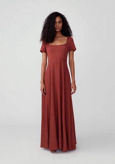 Woman in red ochre scoop neck gown front.
