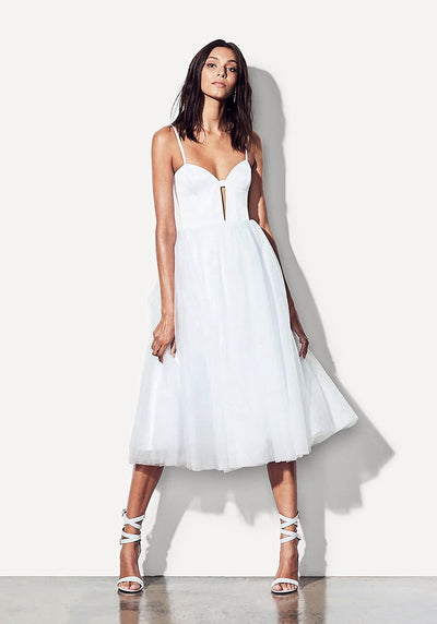 Woman in white fit and flare midi dress front.