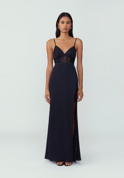 Woman in black sheer midriff maxi dress front.