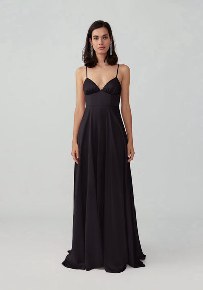 Woman in black v neck maxi gown front.