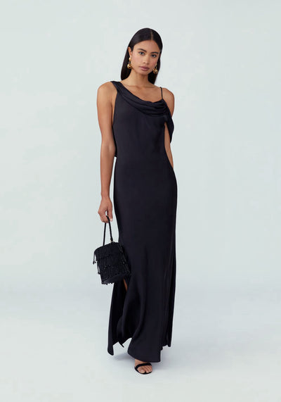 Woman in black drape neckline slip dress front.