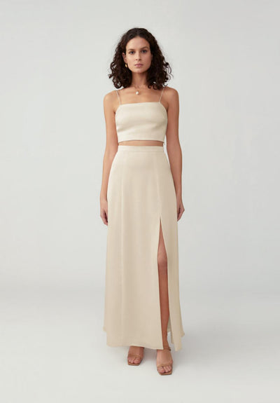 Woman in champagne two piece straight neck set front.