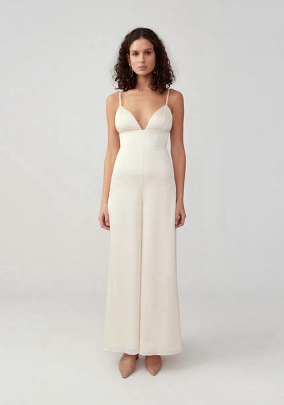 Woman in champagne triangle cup wide leg jumpsuit front.