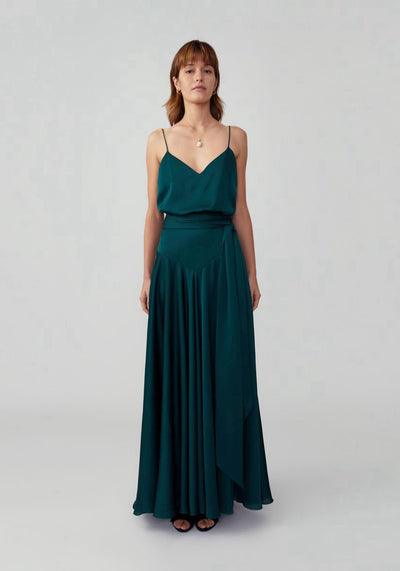 Woman in dark forest tie waist flared dress front.
