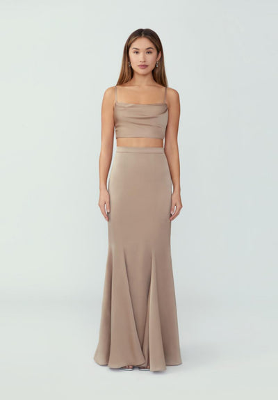 Woman in dark tan two piece crop top maxi dress front.