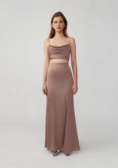 Woman in dark tan two piece dress front.