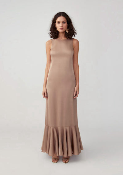 Woman in dark tan ruffle hem dress front.