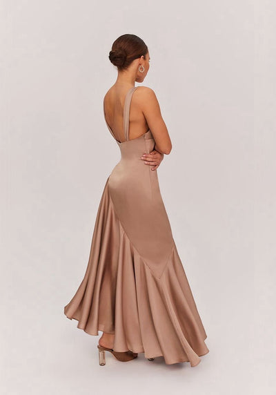 Woman in dark tan dress side.
