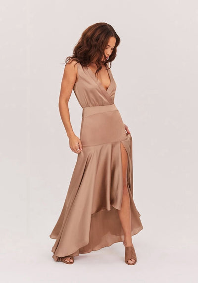 Woman in dark tan thigh high split dress front.