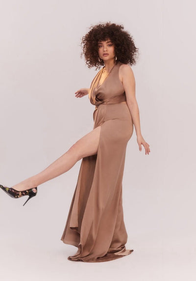 Woman in dark tan draped front maxi dress side.