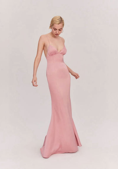 Woman in dusty rose maxi slip dress front.