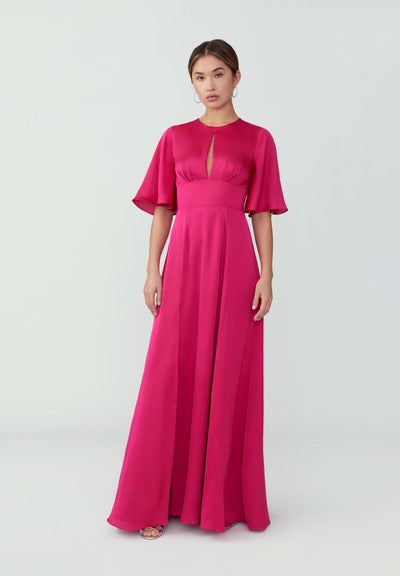 Woman in hot pink sleeved maxi gown front.