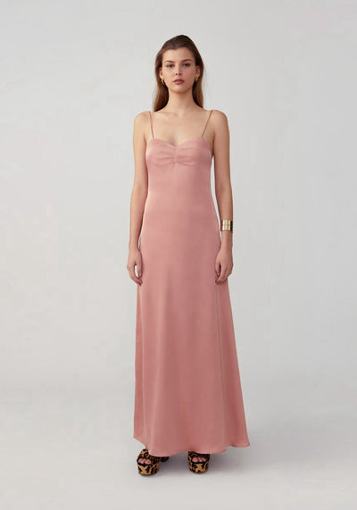 Woman in warm blush thin strap maxi dress front.