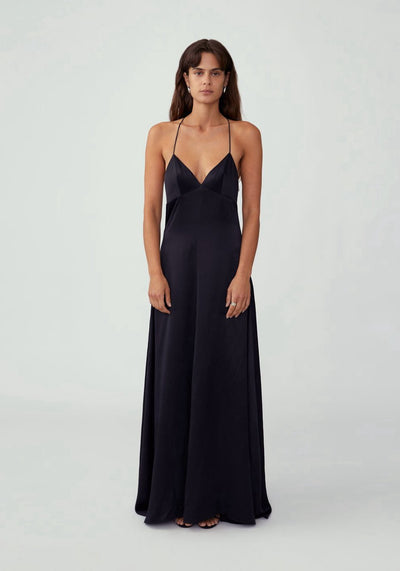 Woman in black v neck a line maxi dress with train front.
