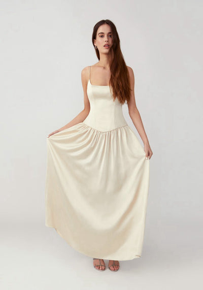 Woman in champagne full skirt maxi dress front.