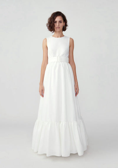 Woman in ivory full skirt belted dress front.