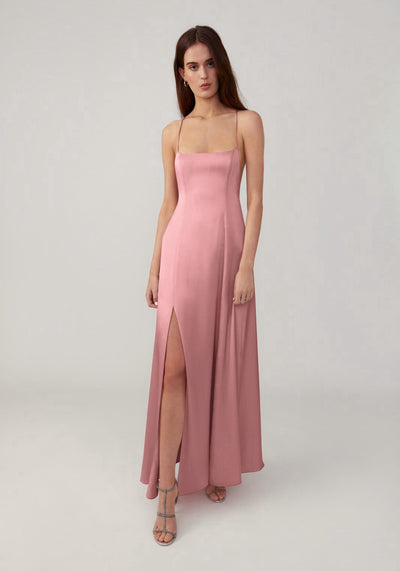 Woman in pink slim fitting dress front.