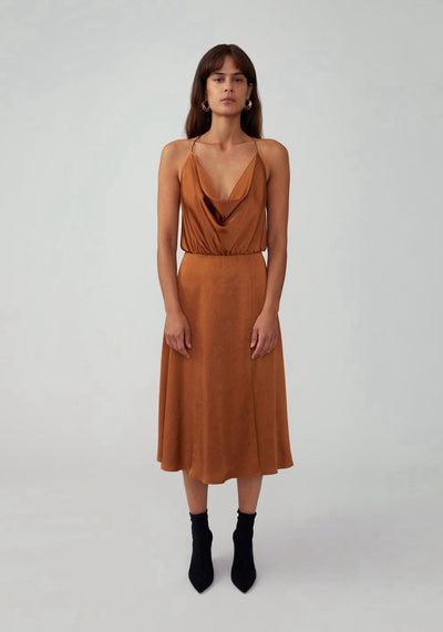 Woman in butterscotch cowl neck midi dress front.