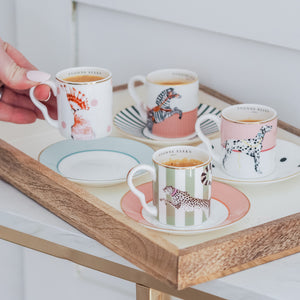 Four espresso cups on a tray