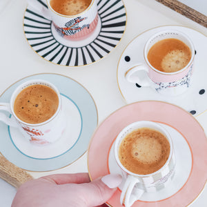 Four espresso cups and saucers