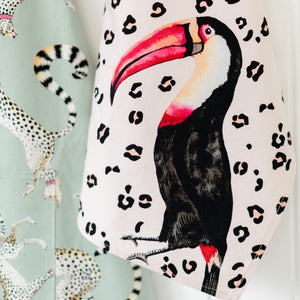 Load image into Gallery viewer, Toucan tea towel with cheetah apron