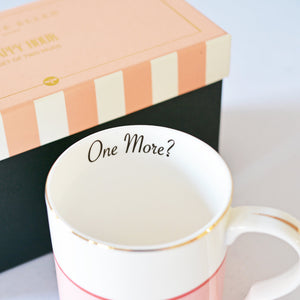 Inside of mug with One More? slogan
