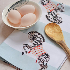 Zebra tea towel with eggs and wooden spoon