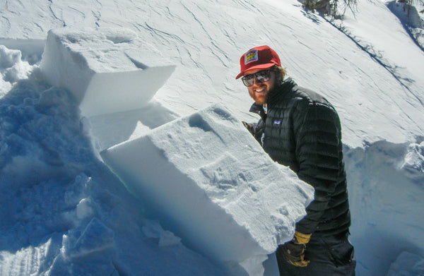 A student inspecting the results of an extended column test during an AIARE 1 avalanche course