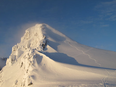 Backcountry skiing on a ridge at Icefall Backcountry Lodge