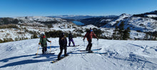 Load image into Gallery viewer, Participants posing for a photo above Donner Lake during the Blackbird AIARE Avalanche Rescue Course at Donner Ski Ranch