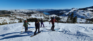 Participants posing for a photo above Donner Lake during the Blackbird AIARE Avalanche Rescue Course at Donner Ski Ranch