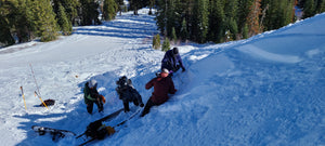 Rescuers performing an avalanche rescue during the Blackbird Lift Accessed AIARE Avalanche Rescue Course at Donner Ski Ranch