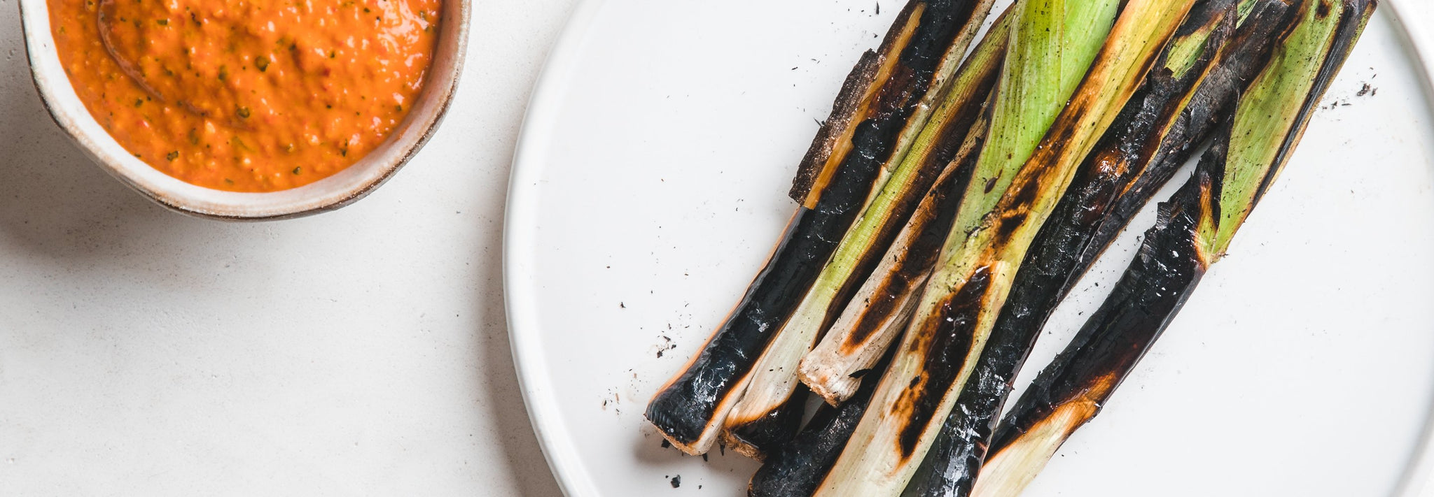 Charred Baby Leeks with Romesco Sauce