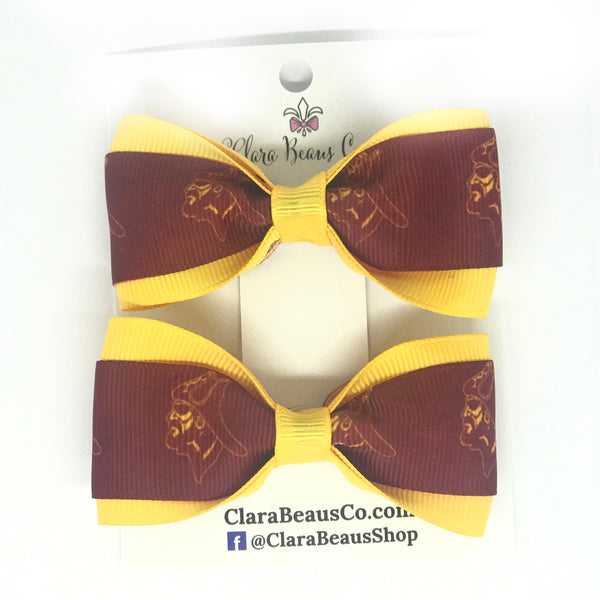 Chartiers-Houston logo pig tail hair bows
