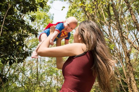 mother with baby superman