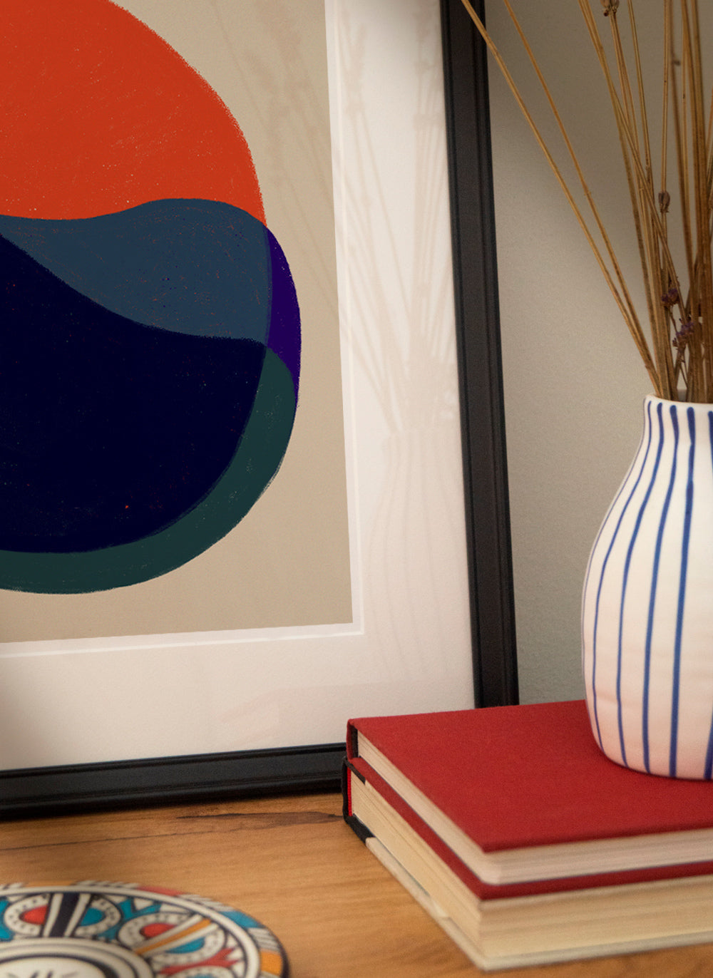 Framed artwork with decor objects