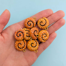 Load image into Gallery viewer, Handful of miniature handmade cinnamon buns