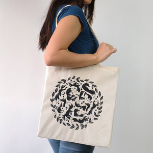 Model with screen printed fox tote bag