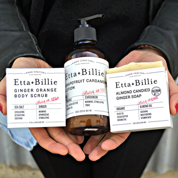 person holding etta and billie lotion and body scrubs