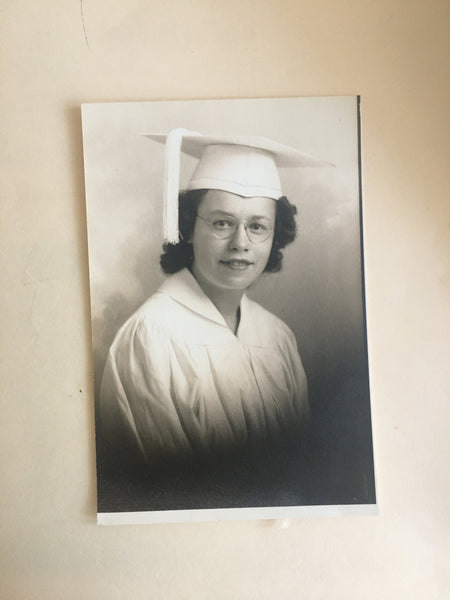 Family picture of Grandma Etta at her graduation in cap and gown