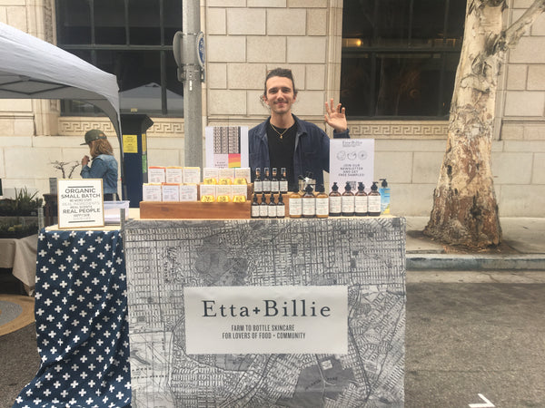 person stands at etta and billie stand at outdoor market