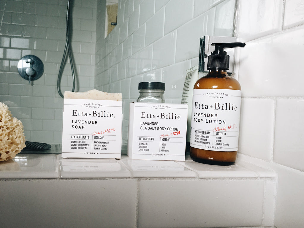 etta and billie subscription soap, scrub, and lotion on shower shelf