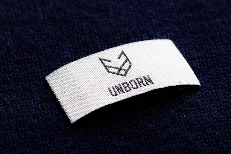 Unborn Brand Label placed on knitted merino fabric