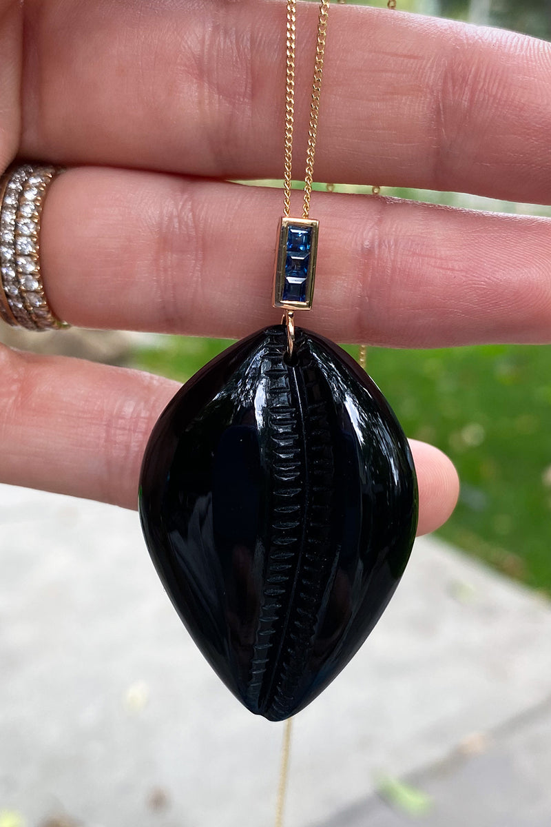 GRANDE CARVED COWRY WITH SAPPHIRE AND SHARK FIN ENAMELING IN ONYX