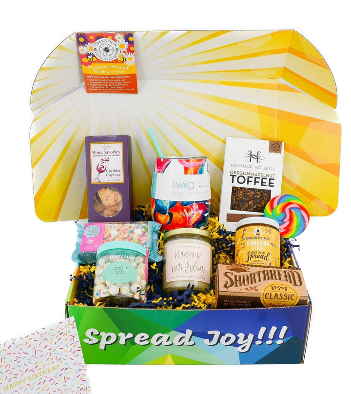 Birthday Gift Box is packed full of yummy treats, candle, tumbler, birthday card and more! Toffee, Honey Spread, Cookies, Cupcake bites, Birthday cake Treat and wine crackers!