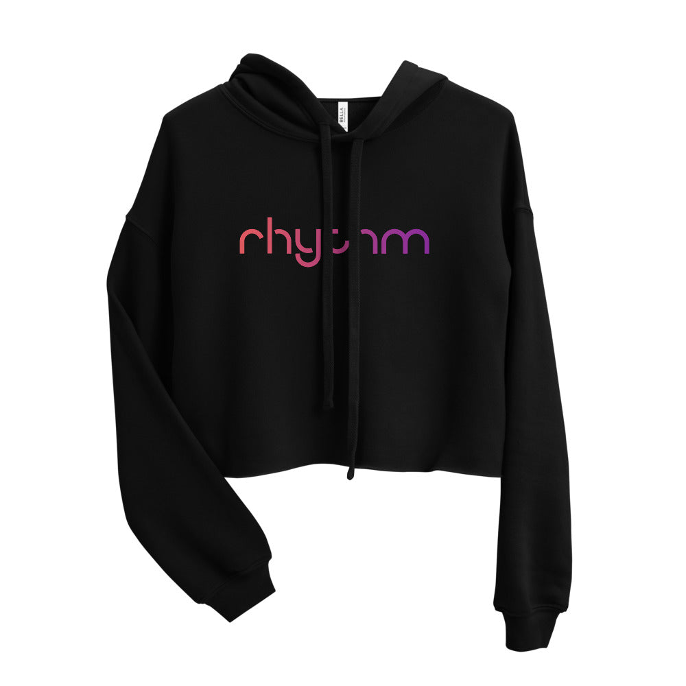Woman in Rhythm black cropped hoodie with rainbow logo