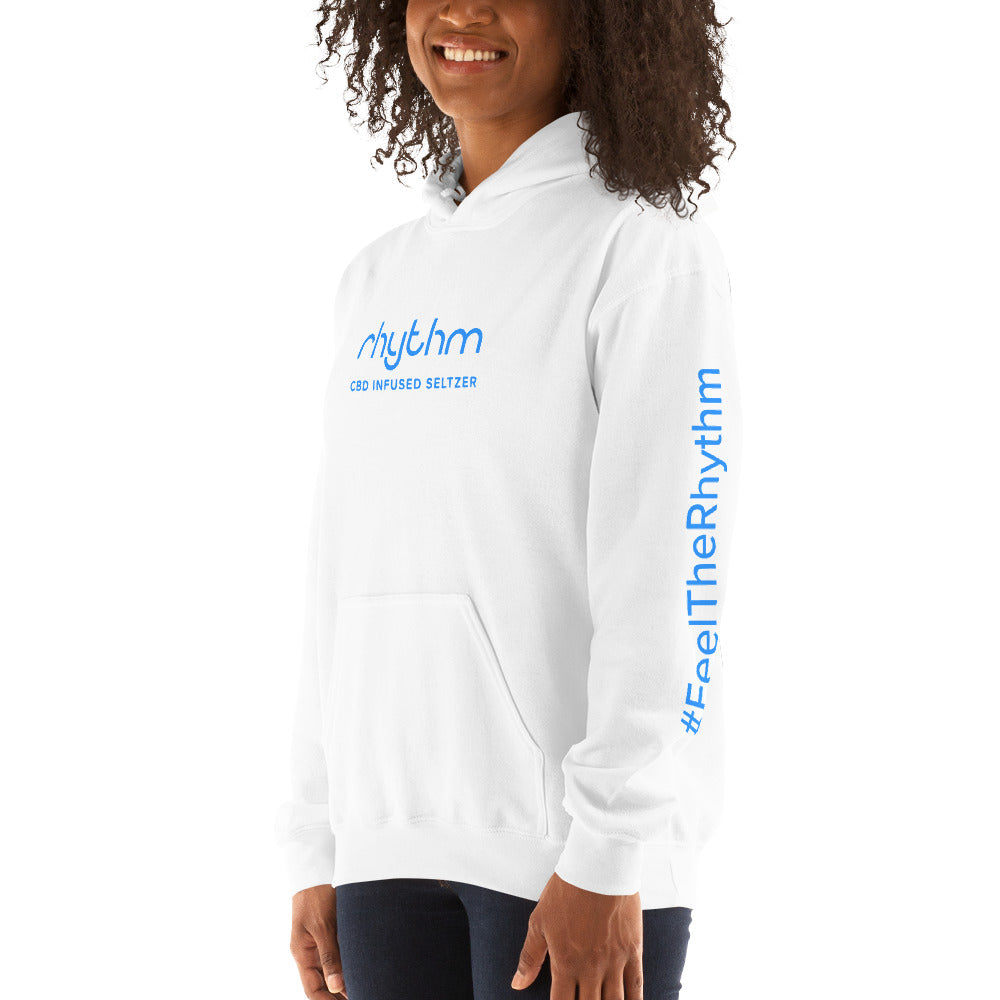 Woman wearing white Rhythm hoodie with blue logo